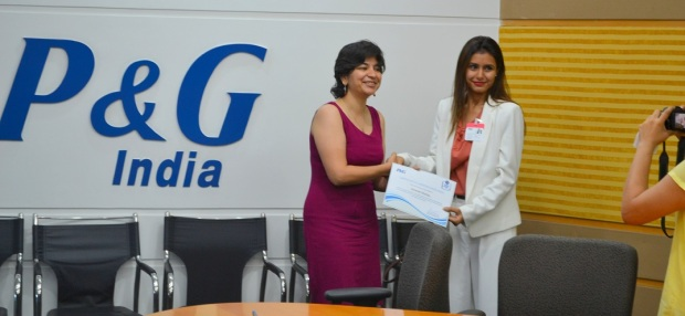 Being felicitated by Ms. Sonali Dhawan, Marketing Director of P & G - India